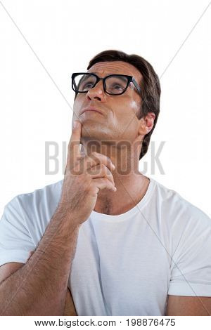 Thoughtful mature man with hand on chin against white background
