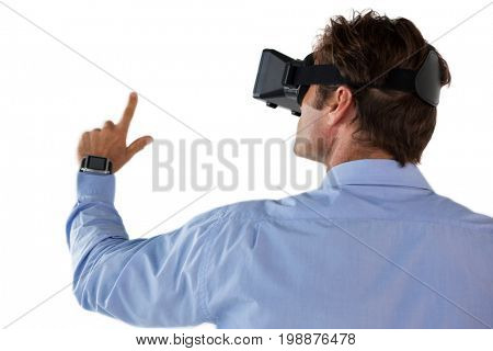 Rear view of businessman gesturing while using vr glasses against white backgrond