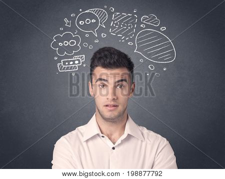 Young casual businessman with drawn speech bubbles over his head