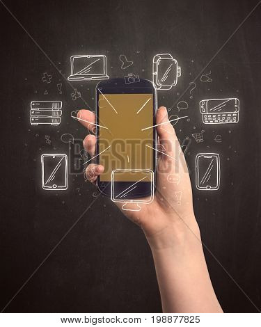 Caucasian hand in business suit holding a smartphone with hand-drawn icons
