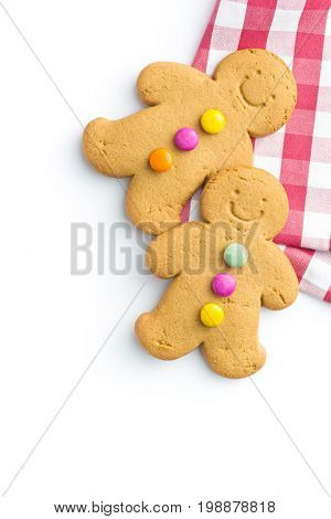 Two sweet gingerbread men isolated on white background. Xmas gingerbread. Laughing gingerbread man.