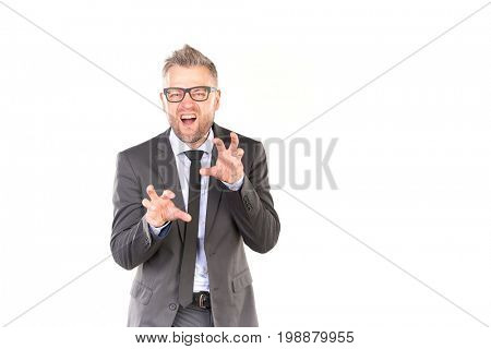Portrait of playful business man pretending to be furious and aggressive