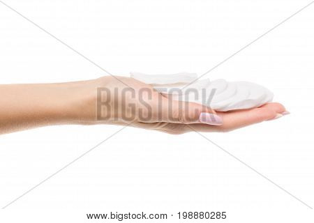 Wadded disks in a female hand on a white background isolation