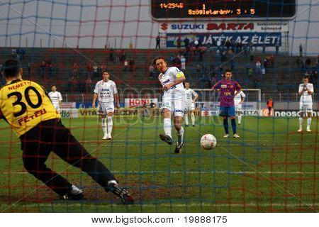 SZEKESFEHERVAR, HUNGARY - MARCH 17: Krisztian Zahorecz shoots it the penalty at a Hungarian National Championship soccer game Kaposvar vs. FC Fehervar March 17, 2007 in Szekesfehervar, Hungary