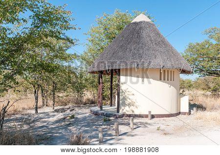 ETOSHA NATIONAL PARK NAMIBIA - JUNE 21 2017: Thatched toilet facilities on the C38-road between Namutoni and Halali in the Etosha National Park Namibia