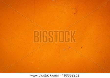 Background Of An Orange Stucco Coated And Painted Exterior, Rough Cast Of Cement And Concrete Wall T