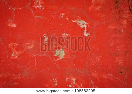 Background Of A Red Stucco Coated And Painted Exterior, Rough Cast Of Cement And Concrete Wall Textu