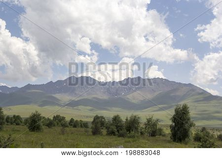 High Mount Elbrus, snow tops in white clouds, mountains of the North Caucasus