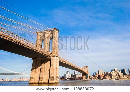 Brooklyn Bridge over East River viewed from New York City, USA