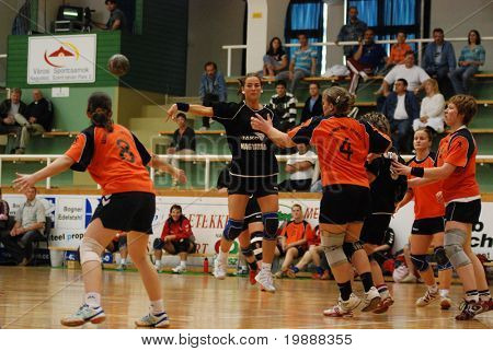 KAPOSVAR, HUNGARY - MAY 18: Piroska Kosar (with the ball) in action at Hungarian Handball National Championship I/B. match (Nagyatad vs. Szombathely) May 18, 2007 in Kaposvar, Hungary.