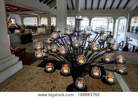 PUNTA CANA DOMINICAN REPUBLIC - MARCH 19 2017: A creative tree formed from natural candles inside the lobby of the Paradisus Hotel in Playa Bavaro in the Caribbean. The light is natural twilight.