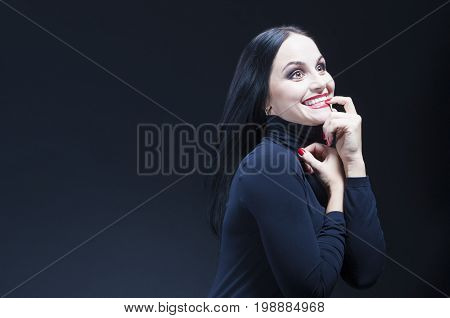 Portrait of Mid-aged Curious and Smiling Caucasian Brunette Woman. Horizontal Image Composition