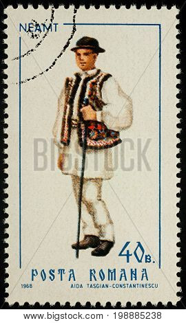 Moscow Russia - August 08 2017: A stamp printed in Romania shows young man in Romanian national costume Neamt county series
