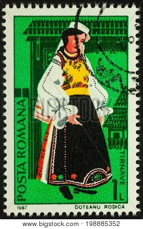 Moscow Russia - August 07 2017: A stamp printed in Romania shows young woman in Romanian national costume Tirnave region series