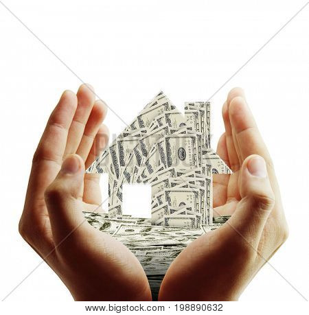 Business's hand holds house model made from American dollars money, isolated on white, Financial, banking and real estate or property development business process concept