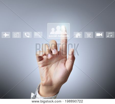 Businessman pushing internet social media button icon on mobile application,from other phone app icons symbols like music player, phone, home button, communication concept
