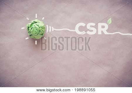 Green paper light bulb with CSR Corporate social responsibility
