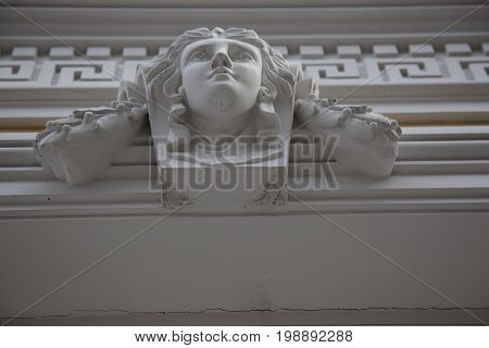 Wall historical building bas-relief female old art deoration culture Russia