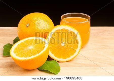 Navel orange fruit and juice on wooden background,Healthy food