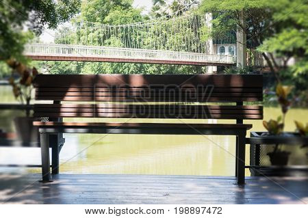 Wooden bench in a water house garden stock photo
