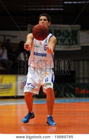 KAPOSVAR, HUNGARY - OCTOBER 24: Gergely Kutasi (6) in action at a Hugarian Champonship basketball game Kaposvar vs. Szeged October 24, 2010 in Kaposvar, Hungary.