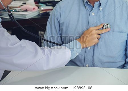Close up of doctor listening to patient heartbeat with stethoscope on hospital Physical examination Medical and health care concept.