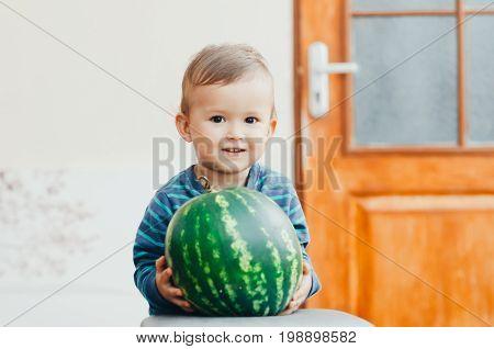 A Little Boy Enjoys Watermelon