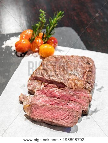 Prime tenderloin beef steak served with grilled tomato with sea salt