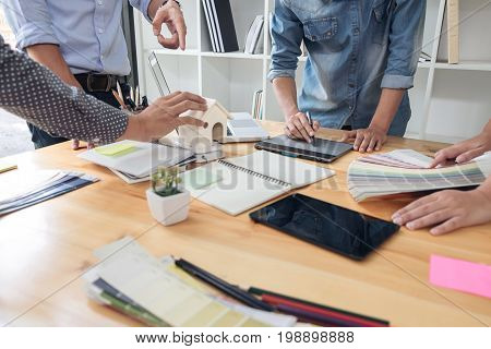 Young colleagues designers working together on a creative project and color samples for selection Color swatch samples Brainstorming Planning Partnership creative graphic design working desktop.