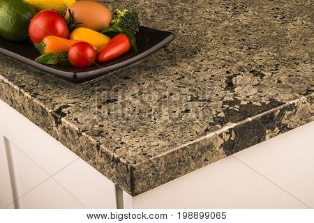 Countertops. Granite countertops. Kitchen granite countertops. Various colorful  vegetables on kitchen granite counter top. Countertop concept.