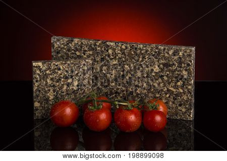 Kitchen. Counter top slabs with red tomatoes. Granite counter tops. Stone samples made of granite counter top. Counter concept.