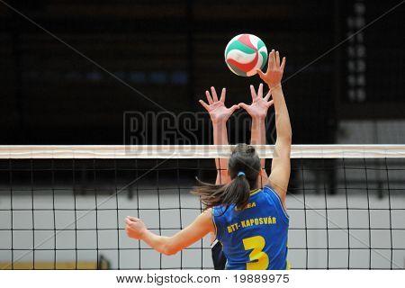 KAPOSVAR, HUNGARY - OCTOBER 31:Zsofia Harmath (3) strikes the ball at the Hungarian NB I. League woman volleyball game Kaposvar vs Ujbuda, October 31, 2010 in Kaposvar, Hungary.
