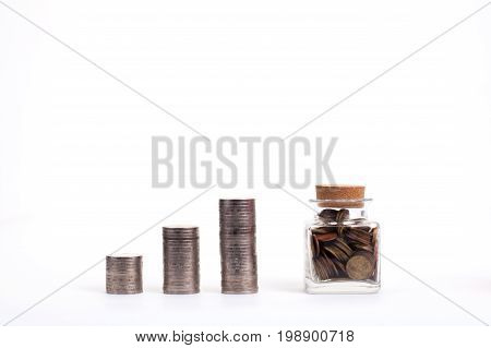 Saving money concept Money jar and coins on white background