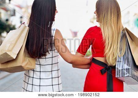 Beautiful Girls With Shopping Bags