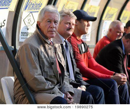 KAPOSVAR, HUNGARY - NOVEMBER 6: Gyorgy Mezey (L) (Videoton trainer) at a Hungarian National Championship soccer game Kaposvar vs Videoton FC November 6, 2010 in Kaposvar, Hungary.