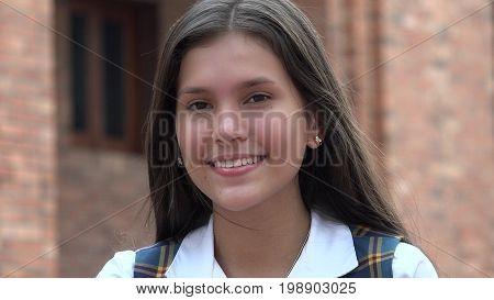 Pretty Hispanic Female Teen with Brick Wall Background