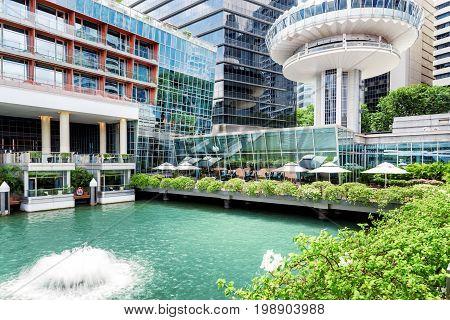 Amazing Outdoor Pool With Azure Water Among Modern Buildings