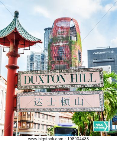 Scenic Bilingual Street Sign At Duxton Hill In Singapore