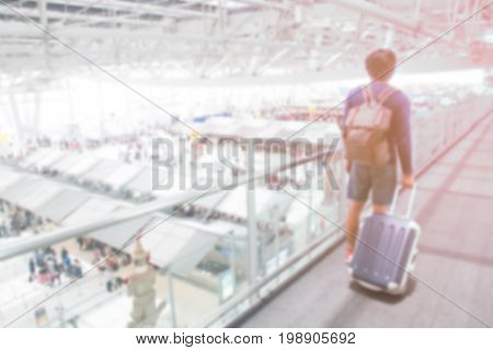 Abstrack blur airport interior with traveler dragging luggage poster
