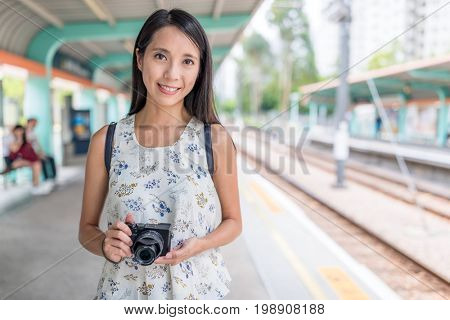 Woman go travel with her camera