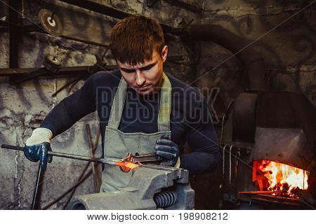 industrial machinist working on vice grip in workshop poster