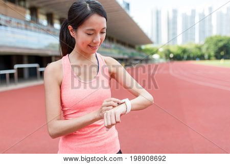 Sport woman using wearable smart watch