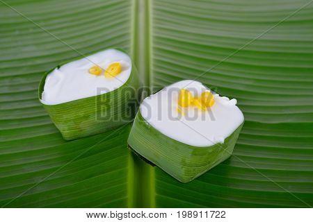 authentic Thai dessert Creamy Coconut Tapioca and Corn Pudding on banana leaf background