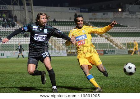 KAPOSVAR, HUNGARY - NOVEMBER 24: Krisztian Zahorecz (L) in action at a Hungarian Liga Cup soccer game Kaposvar vs BFC Siofok November 24, 2010 in Kaposvar, Hungary.