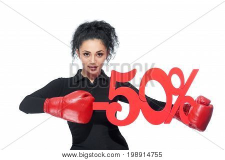 Sexy young brunette woman wearing boxing gloves punching -50 discount sign sale sales offer pricing shopping consumerism buying purchasing concept.