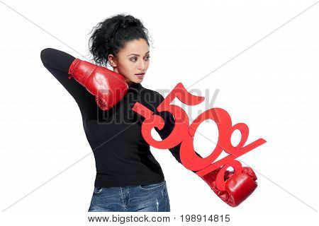 Shot of a sexy dark haired woman wearing red boxing gloves fighting price percentage sign punching -50 symbol isolated on white consumerism shopping purchase retail sales discount concept.