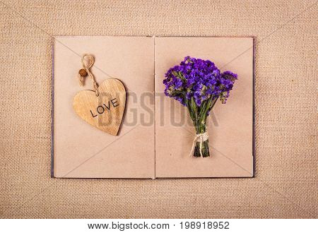Open book heart bookmark and flowers. Romantic concept.