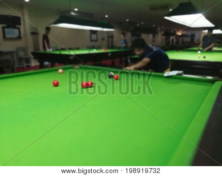 Blurred images of snooker players in the Association of Thailand