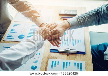 Business Teamwork joining hands team spirit concept