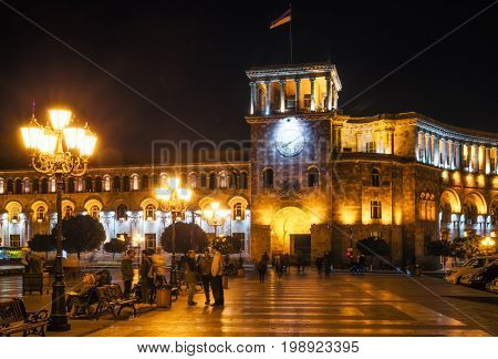Yerevan Armenia. September 10 2016: Local residents and tourists are walking along the street of Yerevan against The Government of the Republic of Armenia on Republic Square in Yerevan at night
